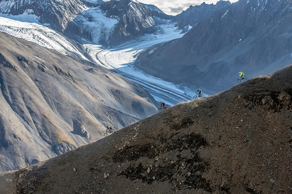 Tyler McCaul, Carson Storch, Wade Simmons and Darren Berrecloth ride down a previously untouched slope in the Tatshenshini-Alsek Provincial Park in British Columbia, Canada on September 3, 2016.