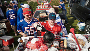 """SHOT 10/22/17 9:43:57 AM - Pouring shots of traditional Polish cherry vodka into a bowling ball while tailgating at the Hammer's Lot at the Pinto Ron tailgate party before the Buffalo Bills faced the Tampa Bay Buccaneers in Orchard Park, N.Y. Ken Johnson, better known as """"Pinto Ron"""", (born 1958) is a Buffalo Bills fan known for attending every single Bills home and away game and hosting a tailgate party since 1994. He is known for his red Ford Pinto and antics cooking food on his car hood in a variety of objects such as a shovel and army helmet; furthermore, he holds a tradition of being doused in ketchup and mustard. Most notably he served shots out of a bowling ball until he was forced to shut down by the National Football League (NFL) Johnson moved his tailgate party to private property next to the stadium where the NFL has no jurisdiction and was able to resume serving bowling ball shots. He has been featured in multiple NFL Films, as well as the made-for-TV movie Second String. (Photo by Marc Piscotty / © 2017)"""