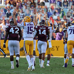 Sep 26, 2020; Baton Rouge, Louisiana, USA; LSU Tigers quarterback Myles Brennan (15) celebrates a touchdown against the Mississippi State Bulldogs during the second half at Tiger Stadium. Mandatory Credit: Derick E. Hingle-USA TODAY Sports