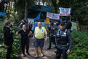 Bailiffs and officials leave after serving legal documents in connection with an extended injunction recently granted to HS2 Ltd by the High Court to persons believed to be former inhabitants of a wildlife protection camp occupied by anti-HS2 activists on 21 September 2020 in Denham, United Kingdom. Anti-HS2 activists continue to try to prevent or delay works for the controversial £106bn HS2 high-speed rail link on environmental and cost grounds from a series of protection camps based along the route of the line between London and Birmingham.