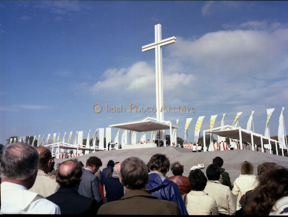 Pope John-Paul II visits Ireland..1979..29.09.1979..09.29.1979..29th September 1979..Today marked the historic arrival of Pope John-Paul II to Ireland. He is here on a three day visit to the country with a packed itinerary. He will celebrate mass today at a specially built altar in the Phoenix Park in Dublin. From Dublin he will travel to Drogheda by cavalcade. On the 30th he will host a youth rally in Galway and on the 1st Oct he will host a mass in Limerick prior to his departure from Shannon Airport to the U.S..On a beautiful day the Iconic Cross dominates the skyline at Phoenix Park.