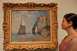 © under license to London News Pictures. 25/06/12. London, UK. A visitor admires the famous paining, The Cliffs at Etretat, 1885, by Claude Monet, .The exhibition takes place at the Royal Academy of Arts. From Paris: A Taste of Impressionism - paintings from the Clark exhibition. The exhibition showcases seventy major works, many of which have never been on public display in the U.K before...ALEX CHRISTOFIDES/LNP