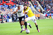 Bolton Wanderers' Darren Pratley and Brentford's Jota chase the ball. Skybet football league championship match, Bolton Wanderers v Brentford at the Macron stadium in Bolton, Lancs on Saturday 25th October 2014.<br /> pic by Chris Stading, Andrew Orchard sports photography.