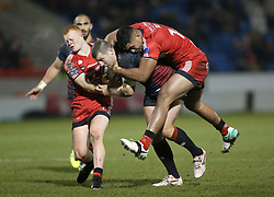 Wigan Warriors Tony Club is tackled by Salford Red Devils Lama Tasi during the Betfred Super League match at the AJ Bell Stadium, Salford.