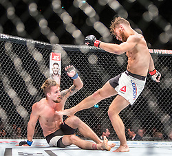 Teemu Packalen of Finland fights Mickael Lebout of France in their lightweight fight during the UFC Fight Night Glasgow on Saturday, July 18 at The SSE Hydro, Glasgow. The UFC Fight Night 72 event was the first the promotion had been hosted in Scotland.