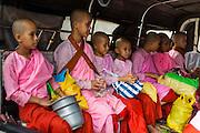 04 JUNE 2014 - YANGON, YANGON REGION, MYANMAR: Buddhist nuns in the back of a pickup truck in Yangon, Myanmar.      PHOTO BY JACK KURTZ