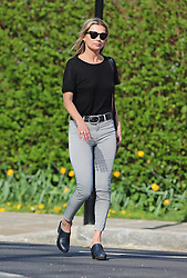 Supermodel Kate Moss wearing a black top, stripy trousers and a pair of clogs out enjoying the sunshine in north London, UK. 15/04/2015<br /> BYLINE MUST READ : JAMESY/GOTCHA IMAGES<br /> <br /> Copyright by © Gotcha Images Ltd. All rights reserved.<br /> Usage of this image is conditional upon the acceptance <br /> of Gotcha Images Ltd, terms and conditions available at<br /> www.gotchaimages.com