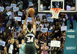October 17, 2018 - Charlotte, NC, USA - Charlotte Hornets fans try to distract Milwaukee Bucks forward Giannis Antetokounmpo (34) as he shoots free throws in the second half at the Spectrum Center in Charlotte, N.C., on Wednesday, Oct. 17, 2018. The Bucks won, 113-112. (Credit Image: © David T. Foster Iii/Charlotte Observer/TNS via ZUMA Wire)