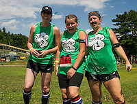 "The ""Beer-ly There"" team of Beth Glover, Nicole Brown and Carol Chase watch as their team mate Bob Chase nativages the Slip 'N Dip event during Gunstock Mountain's Craft Beer Relay on Saturday.  (Karen Bobotas/for the Laconia Daily Sun)"