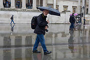 The photographer Nils Jorgensen walks in front of the National Gallery in Trafalgar Square, Westminster, on 9th April 2019, in London, England.