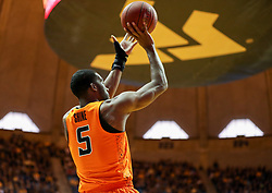 Feb 10, 2018; Morgantown, WV, USA; Oklahoma State Cowboys guard Tavarius Shine (5) shoots a jumper during the first half against the West Virginia Mountaineers at WVU Coliseum. Mandatory Credit: Ben Queen-USA TODAY Sports