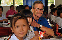 Warriors Journey Home member Tom Saal, of Akron, visits the Mac Dinh Chi school in Quang Nam, that was funded and built by his Marine Corps Officer class.  Saal gave away about one hundred beanie babies to the school children he met along the journey. (Laura FongTorchia/Special to the Akron Beacon Journal)