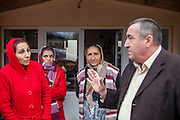 Portrait of Ilie Dumitru (right) - ex Roma local councilor - discussing with local inhabitants of Zavraci (part of Marginenii de Jos) issues regarding a better community infrastructure as a new road and a water pipe system. He is still very respected in the community and often involved in issues regarding the village.