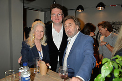 Left to right, JENNY DE YONG, EWAN VENTERS and HOWARD JACOBSON at a party to celebrate the launch of Top Dog at 48 Frith Street, Soho, London on 27th May 2015