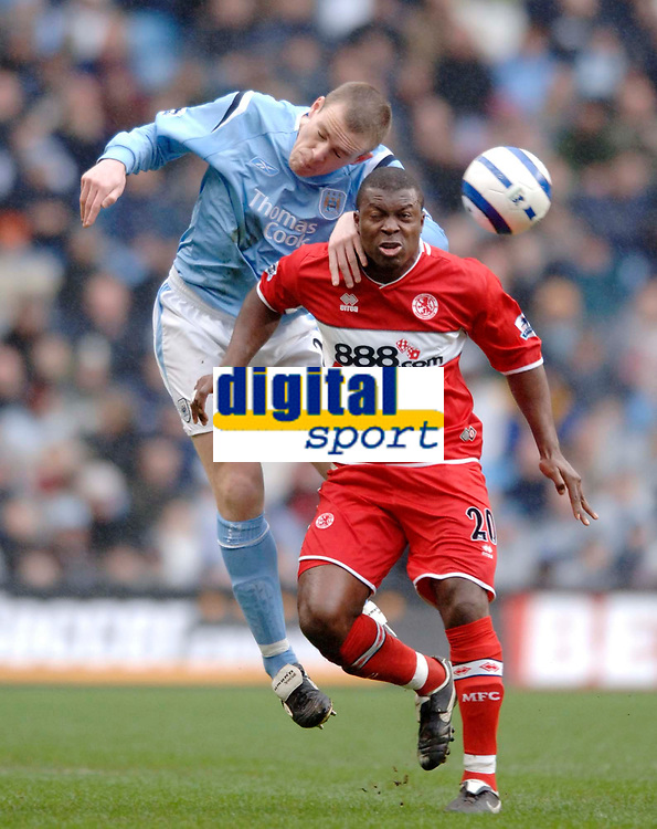 Photo: Glyn Thomas.<br />Manchester City v Middlesbrough. The Barclays Premiership. 02/04/2006.<br /> Man City's Richard Dunne (L) battles for the ball with Yakubu.