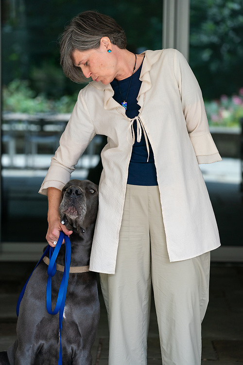 The Ambassador and one of her dogs, Caesar.