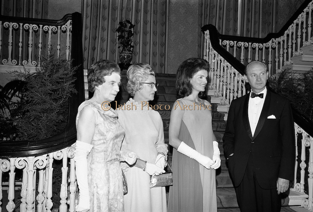 An Taoiseach Mr. Jack Lynch T.D. entertains  Mrs. Jackie Kennedy at a reception at St. Patrick's Hall, Dublin Castle.Jackie Kennedy with her hosts Jack Lynch and his wife in the reception hall of Dublin Castle where she attended her first formal function since her arrival in Ireland. On the left is Mrs. Frank Aiken.<br /> 30.06.1967