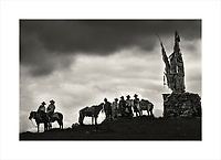 Tibetan horsemen attending a horse festival at Shamalong in Sichuan Province, China. When I spotted the riders, silhouetted against a dark foreboding sky, it immediately reminded me of a scene from a classical Western.<br /> Purchase a signed and numbered limited edition fine art print of this image from www.hanskemp.com/store