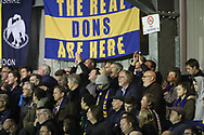 AFC Wimbledon fans singing during the The FA Cup match between AFC Wimbledon and Lincoln City at the Cherry Red Records Stadium, Kingston, England on 4 November 2017. Photo by Matthew Redman.