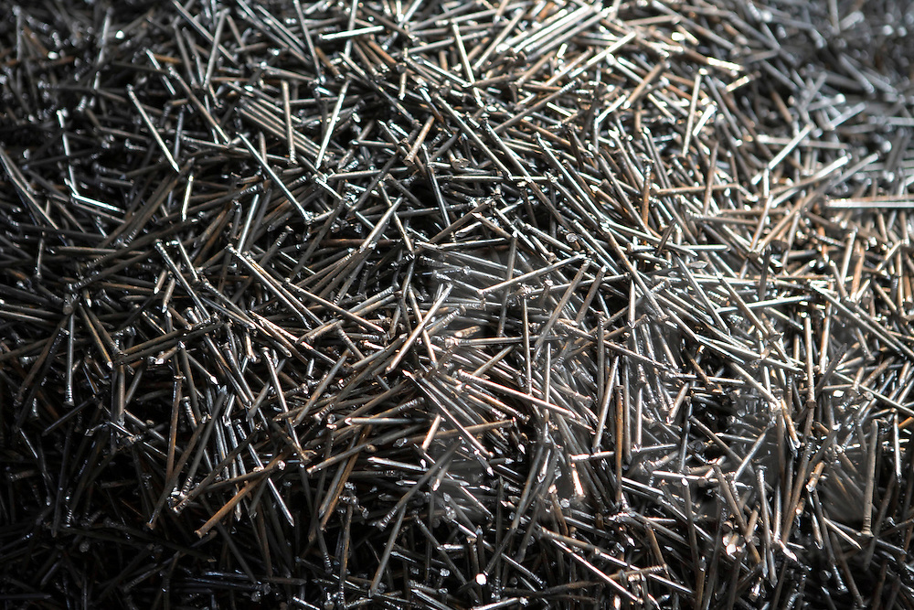 Color film photograph of a pile of metallic pieces in Da Hoi steel production craft village, Hanoi outskirts, Vietnam, Southeast Asia