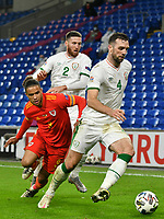 Football - 2020/2021 UEFA Nations League - Group B4 - Wales vs Republic of Ireland - Cardiff City Stadium<br /> <br /> Shane Duffy on the attack chased by Tyler Roberts of Wales<br /> in a match played without fans<br /> <br /> COLORSPORT/WINSTON BYNORTH