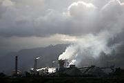 Sunlight shines on smoke from Fosfertil fertiliser factory, Cubatão