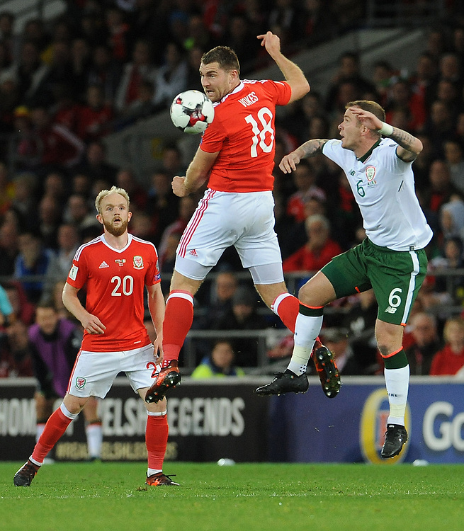 Wales'  Sam Vokes beats Ireland's Glenn Whelan to the header <br /> <br /> Photographer Ian Cook/CameraSport<br /> <br /> FIFA World Cup Qualifying - European Region - Group D - Wales v Republic of Ireland - Monday 9th October 2017 - Cardiff City Stadium - Cardiff<br /> <br /> World Copyright © 2017 CameraSport. All rights reserved. 43 Linden Ave. Countesthorpe. Leicester. England. LE8 5PG - Tel: +44 (0) 116 277 4147 - admin@camerasport.com - www.camerasport.com