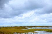 Yacht and salt marsh by Atlantic Ocean on Cape Cod, New England, USA