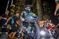 October 31, 2018 - Kuala Lumpur, Malaysia - Malaysian Moto3 rider Adam Norrodin of SIC Racing Team poses with his bike in front of the Malaysia's landmark Kuala Lumpur twin tower in Kuala Lumpur, during a MotoGP pre-event ahead of Malaysian Grand Prix, on October 31, 2018. (Credit Image: © Zahim Mohd/NurPhoto via ZUMA Press)