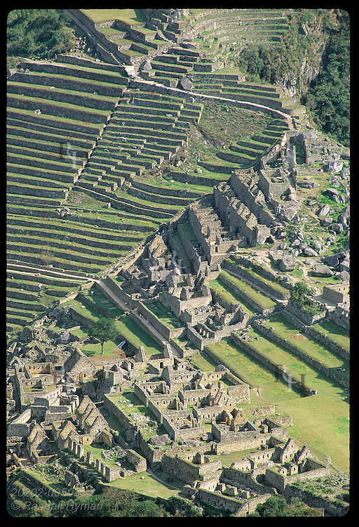 Agricultural terraces and both urban sectors stand out in view from Huayna Picchu; Machu Picchu Peru