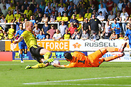 Burton Albion  forward Liam Boyce (27) and Wimbledon goalkeeper Tom King (1), on loan from Millwall,  during the EFL Sky Bet League 1 match between Burton Albion and AFC Wimbledon at the Pirelli Stadium, Burton upon Trent, England on 1 September 2018.