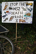 A sign depicting all the species believed to be threatened by the HS2 high-speed rail link stands on the edge of a camp pitched by activists from HS2 Rebellion and Extinction Rebellion on 26th June 2020 in Denham, United Kingdom. Activists from HS2 Rebellion and Extinction Rebellion UK are taking part in a 'Rebel Trail' hike along the route of the HS2 high-speed rail link in protest against its environmental impact and to question the viability of the £100bn+ project.