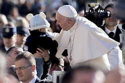 November 9, 2016 - Vatican City, Vatican - Pope Francis leans in to hug a child as he is driven across the crowd ahead of his weekly general audience, in St. Peter's Square, at the Vatican, Wednesday, Nov. 9, 2016. (Credit Image: © Massimo Valicchia/NurPhoto via ZUMA Press)