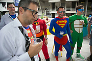 Stag party friends dressed up in superhero costumes start their stag do along the Southbank in London, UK. This is a right of passage style gathering where the objective is to have fun, be a little silly, and drink a considerable amount of alcohol.