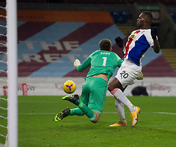 Nick Pope of Burnley (L) saves but gets a knock to the head in the process - Mandatory by-line: Jack Phillips/JMP - 23/11/2020 - FOOTBALL - Turf Moor - Burnley, England - Burnley v Crystal Palace - English Premier League