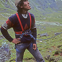 Pasang Ongchu Sherpa prepares to climb a cliff during a mountaineering school operated by Mountain Travel Nepal in September 1980.