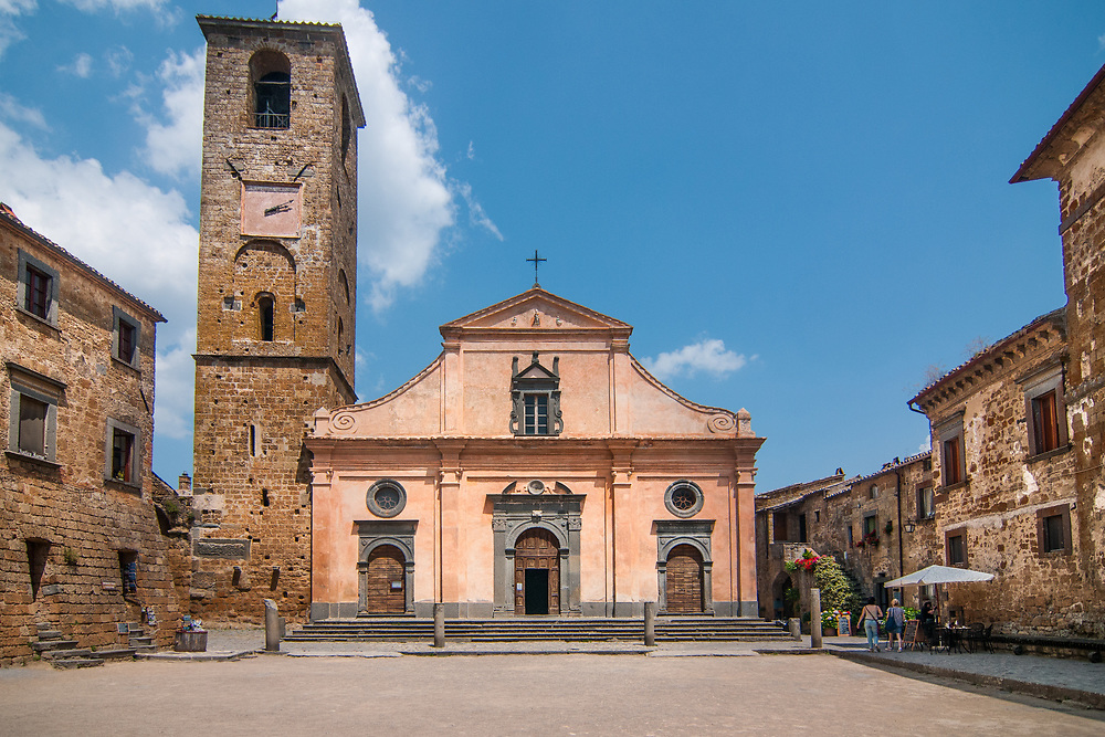 """The church of San Donato in the village of Civita di Bagnoregio.<br /> Civita di Bagnoregio is a town in the Province of Viterbo in central Italy, a suburb of the comune of Bagnoregio, 1 kilometre (0.6 mi) east from it. It is about 120 kilometres (75 mi) north of Rome. Civita was founded by Etruscans more than 2,500 years ago. Bagnoregio continues as a small but prosperous town, while Civita became known in Italian as La città che muore (""""The Dying Town""""). Civita has only recently been experiencing a tourist revival. The population today varies from about 7 people in winter to more than 100 in summer.The town was placed on the World Monuments Fund's 2006 Watch List of the 100 Most Endangered Sites, because of threats it faces from erosion and unregulated tourism."""