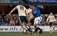 Photo: Ashley Pickering/Sportsbeat Images.<br /> Ipswich Town v Barnsley. Coca Cola Championship. 01/12/2007.<br /> Danny Haynes of Ipswich (blue) tries to find a way past Stephen Foster of Barnsley