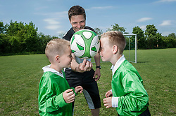Football coach training young players