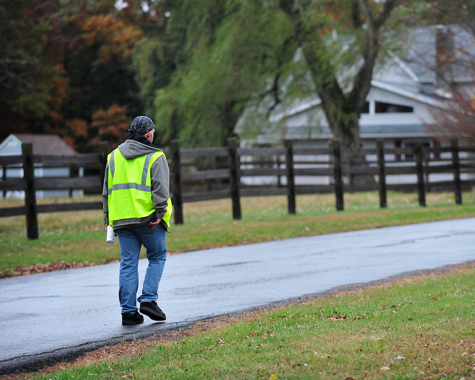 James Tully who police have stopped multiple times because they believe he looks like fugitive Eric Matthew Frein sips coffee on his break outside his place of employment. Oct. 22, 2014, near Canadensis, Pa. (Chris Post   lehighvalleylive.com)