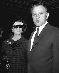 Wearing a plaster on her forehead and dark glasses to hide a black eye, Elizabeth Taylor sets out with her husband Richard Burton from the Dorchester Hotel, London. She received her bruises in an accident when she was playing with her children in the snow.  * during a ski-ing holiday in Switzerland.