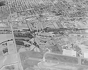 """Ackroyd 12593-1. """"Misc. aerials. June 19, 1964"""" (4x5"""") """"Colwood Golf Course"""" (NE Alderwood Rd & Columbia Blvd. on left is intersection of 82nd & Columbia. The airport is now gone, it is the Jackson Armory on Cornfoot Rd.)"""