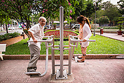 28 MARCH 2012 - HO CHI MINH CITY, VIETNAM: Residents of Ho Chi Minh City, Vietnam, use exercise equipment in a public park. Ho Chi Minh City, which used to be known as Saigon, is the largest city in Vietnam and the commercial hub of southern Vietnam.      PHOTO BY JACK KURTZ
