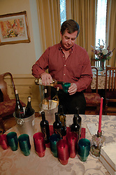 California: Napa City,  man pours Ahnfeldt Wine for patrons of Napa B&B Holiday Tour at McClelland Priest house.  Photo copyright Lee Foster.  Photo # canapa106890