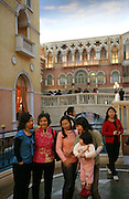 Customers visit the Venetian casino's shopping mall in Macau, China, on February 24, 2008. The Venetian Macao-Resort-Hotel is a 163,000 square foot casino featuring 405 slots and 277 table games. Macao has overtaken Las Vegas with a gambling revenue of 7 billion U.S. dollars in 2006 (Las Vegas' was 6.6 billion U.S. dollars), and is now the world's top casino hut. Photo by Lucas Schifres/Pictobank