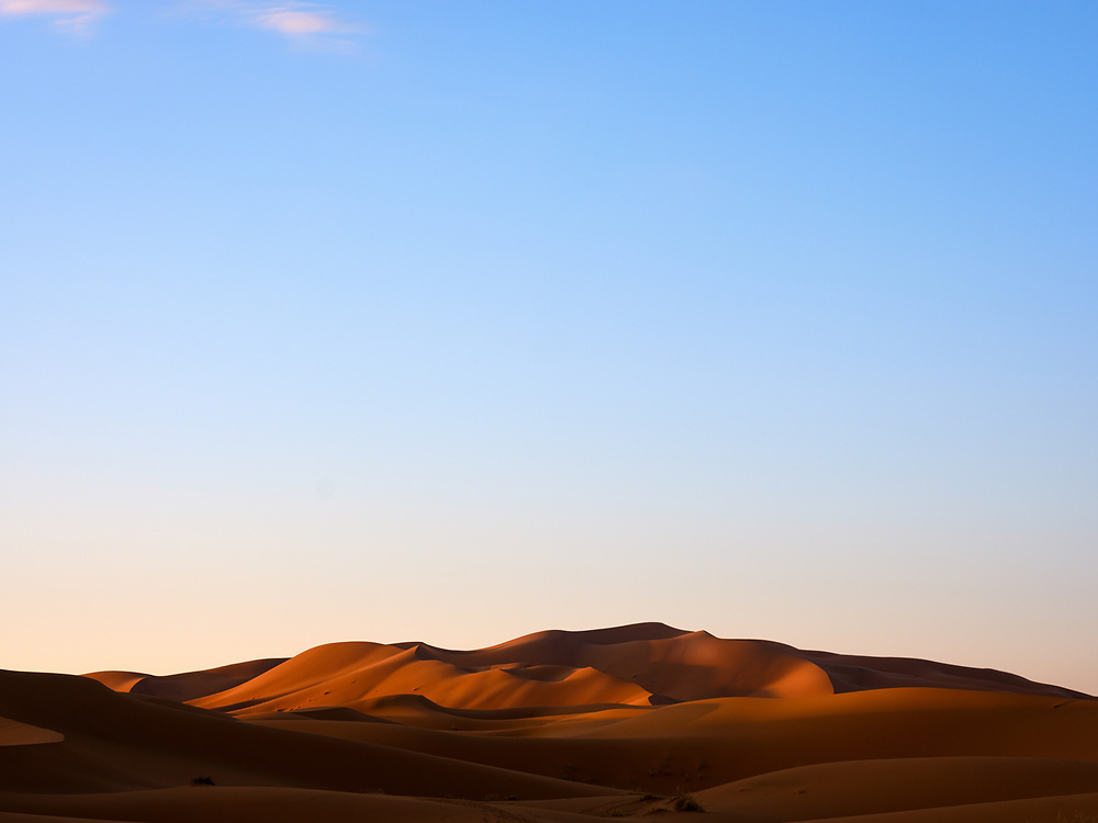 MERZOUGA, MOROCCO - CIRCA MAY 2018: Morning golden light  over the dunes of the Sahara Desert