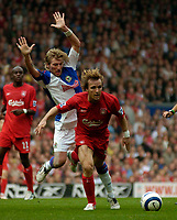 Photo: Glyn Thomas.<br />Liverpool v Blackburn Rovers. The Barclays Premiership.<br />15/10/2005.<br />Liverpool's Bolo Zenden (R) races past Robbie Savage.