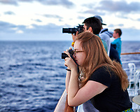 Sunrise photographers lined up on the aft deck of the MV World Odyssey.  Image taken with a Fuji X-T1 camera and 35 mm f/1.4 lens (ISO 200, 35 mm, f/2.2, 1/125 sec).