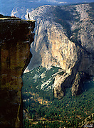 A solitary hiker gazes out over Yosemite Valley from Taft Point.