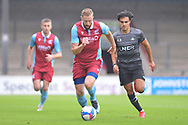 Kevin van Veen (10) of Scunthorpe United running with the ball away from Reece James of Doncaster Rovers u23 during the Pre-Season Friendly match between Scunthorpe United and Doncaster Rovers at Glanford Park, Scunthorpe, England on 15 August 2020.